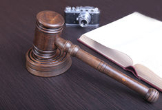 Auction hammer , symbol of authority and vintage camera.  Royalty Free Stock Images