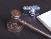 Auction hammer , symbol of authority and vintage camera.  Stock Photography