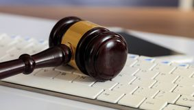 Auction or Judge gavel on a computer keyboard. Online auction concept. Auction or judge gavel on a computer keyboard Royalty Free Stock Images