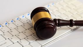 Auction or Judge gavel on a computer keyboard. Online auction concept. Auction or judge gavel on a computer keyboard Stock Photography