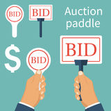 Auction paddle isolated. And holding in hand. A set of tablets. Business bidding process concept. Vector illustration flat design. Template for open trade. Many Royalty Free Stock Photo