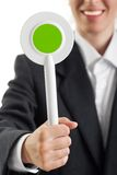 Auction paddle or voting card in hand. Human hand holding auction paddle or voting card Stock Photo