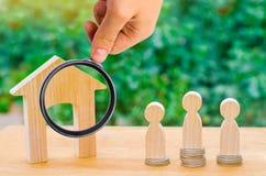 Auction, public sale real estate. wooden house, supermarket trol stock images