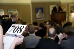 An auction room during a live auction. Royalty Free Stock Photo