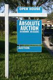 Auction sign. Blue and white Absolute Auction and Open Stock Image