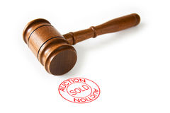Auction Sold Stamp. A brown wooden auctioneers hammer with a red circle sold stamp royalty free stock photography
