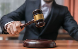 Auctioneer is hitting with gavel. Auction and Justice concept Royalty Free Stock Photography