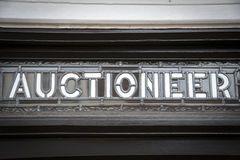 Auctioneer sign. Close up of glass and lead sign outside traditional auctioneer house Royalty Free Stock Photos
