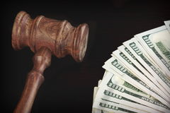 Auctioneers Hammer or Gavel With Money Heap On Black Background Stock Images