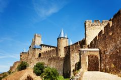 Aude gate and towers of Carcassonne outer wall. Scenic view of Carcassonne outer wall with towers and Aude gate royalty free stock photography