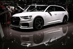 Audi A6 ABT. Geneva, Switzerland - March 10, 2019: White estate car Audi A6 ABT presented at the annual Geneva International Motor Show 2019 royalty free stock photos