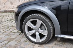 Audi A4 all road close up tire. Shoot Royalty Free Stock Image