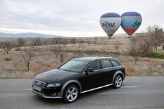 Audi a4 allroad photo shoot and cappadocia balloon in nevsehir Turkey. Audi a4 allroad photo shoot with cappadocia balloons and badlands in Nevsehir Turkey stock image