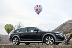 Audi a4 allroad photo shoot and cappadocia balloon in nevsehir Turkey. Audi a4 allroad photo shoot with cappadocia balloons and badlands in Nevsehir Turkey royalty free stock photography