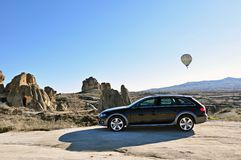 Audi a4 allroad photo shoot and cappadocia balloon in nevsehir Turkey. Audi a4 allroad photo shoot with cappadocia balloons and badlands in Nevsehir Turkey royalty free stock photos