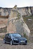 Audi a4 allroad photo shoot and cappadocia fairy chimneys in nevsehir Turkey. Audi a4 allroad photo shoot with cappadocia fairy chimneys and badlands in Nevsehir royalty free stock photography