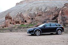 Audi a4 allroad photo shoot and cappadocia fairy chimneys in nevsehir Turkey. Audi a4 allroad photo shoot with cappadocia fairy chimneys and badlands in Nevsehir royalty free stock images