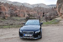 Audi a4 allroad photo shoot and cappadocia fairy chimneys in nevsehir Turkey. Audi a4 allroad photo shoot with cappadocia fairy chimneys and badlands in Nevsehir royalty free stock photo