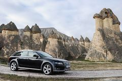 Audi a4 allroad photo shoot and cappadocia fairy chimneys in nevsehir Turkey. Audi a4 allroad photo shoot with cappadocia fairy chimneys and badlands in Nevsehir stock photo