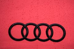 Audi Car Brand Logo In Red. An Audi car brand logo in red painted car in wet surface stock image