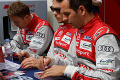 Audi drivers. LE CASTELET, FRANCE, March 28, 2015 : Audi drivers Andre Lotterer, Marcel Fassler and Benoit Treluyer (winners of le Mans 24 hours in 2011, 2012 royalty free stock image