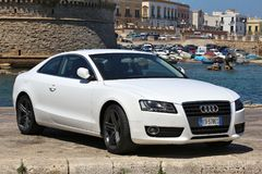 Audi A5. GALLIPOLI, ITALY - MAY 31, 2017: Audi A5 white sporty coupe car parked in Italy. There are 41 million motor vehicles registered in Italy Royalty Free Stock Image