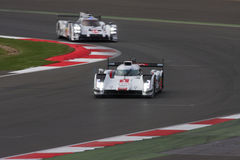 Audi Leading Porsche at Silverstone. Audi R18 e-tron leading a Porsche 919 Hybrid at the 6 hours of Silverstone 2014 royalty free stock photos