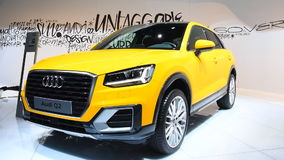 Audi Q2 compact crossover luxury SUV. In bright yellow on display during the 2017 European Motor Show Brussels stock footage