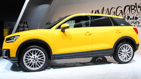 Audi Q2 compact crossover luxury SUV. In bright yellow on display during the 2017 European Motor Show Brussels stock video