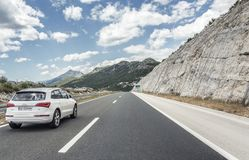 Free Audi Q5 Speeding On The Autobahn Among Mountain Scenery. Stock Photos - 101748473