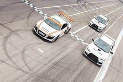 Audi R8 och två Mitsubishi EVO 10 Royaltyfria Bilder