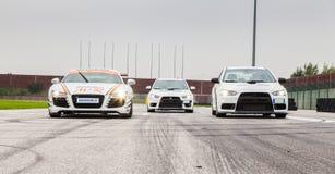 Audi R8 och två Mitsubishi EVO 10 Fotografering för Bildbyråer