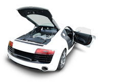 Audi R8 sports car with open engine and door. Rear view of engine and interior of Audi R8 luxury sports car in white Stock Photography