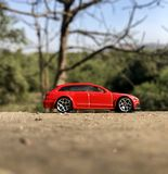 AUDI RS6 The Red hot. Hot-wheels, classic laptop wallpaper, mobile screen, forest,car lovers, nice click,landscape, wood tree, sunny day, bright color stock photography
