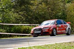 Audi RS4 tuning rally car. Rally car in action on asphalt. Audi RS4 tuning. Panning shot Royalty Free Stock Photo