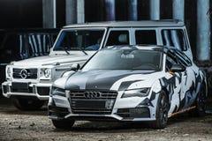 Audi S7 et Mercedes G55 AMG Image libre de droits