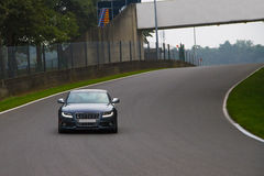 Audi S5 sportscar driving on track. Grey Audi S5 sportscar driving on a race track Stock Image