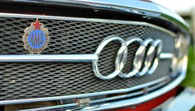 Audi Sign on old Car. Audi sign on an old car. The car is over 40 years old. It looks like he got out of the factory the other day Stock Image