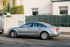 Audi silver limousine parked in city Stock Photos