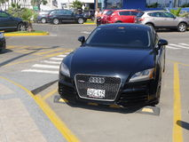 Audi TT RS coupe. Lima, Peru. April 17, 2016. A front view of a parked black color two doors  Audi TT RS coupe. This version of the german Audi TT is the top of Royalty Free Stock Images