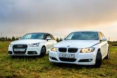 Audi A1 y BMW E90 318i Fotos de archivo libres de regalías