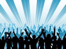 Audience. Silhouette of an audience with their arms raised Royalty Free Stock Photo