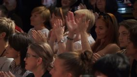 The audience applaud the artists