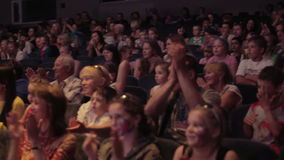 Audience applauded in theater or in cinema. Pan 2 Royalty Free Stock Image