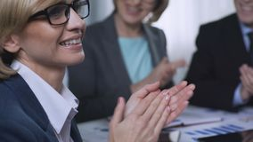 Audience applauding after presentation at round table, business conference. Stock footage stock footage