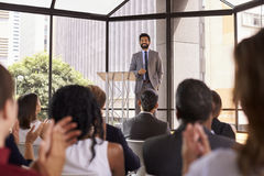 Audience applauding speaker at a business seminar stock photo