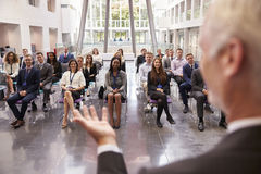 Audience Applauding Speaker After Conference Presentation stock images