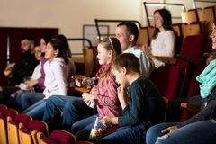 Audience attending movie night for comedy Stock Photos