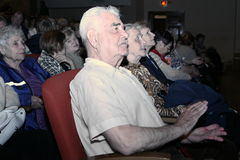The audience and the audience are retired, elderly world war II veterans and their relatives. Stock Photos