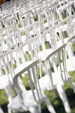 Audience chairs. White plastic chairs set for an outdoor event Stock Photos